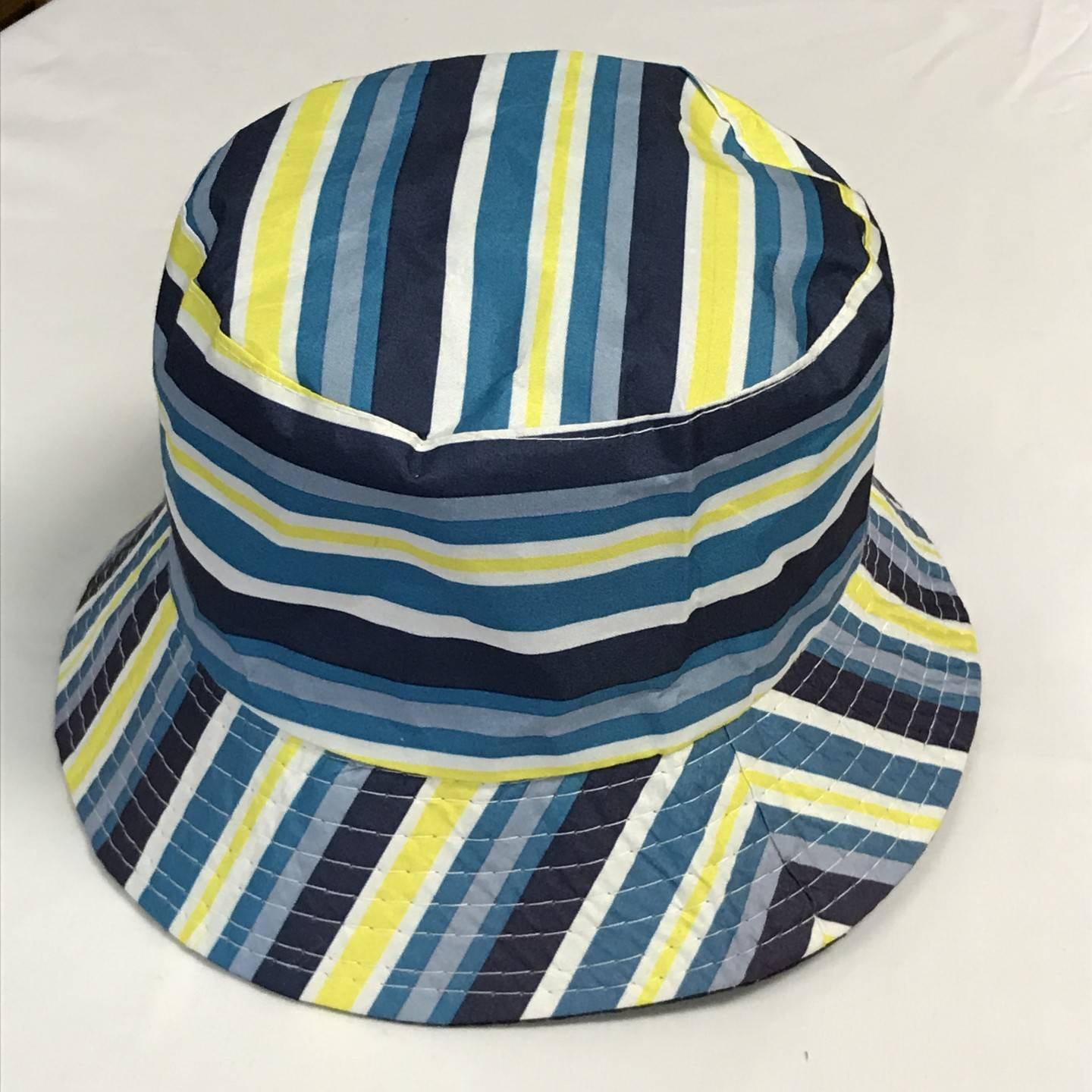 200ee02fcb0 BLUE AND YELLOW REVERSIBLE BUCKET HAT AGES 12+ ...